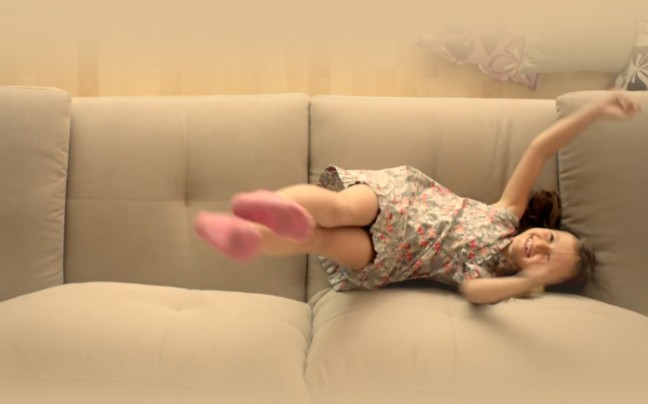Little girl dancing on the couch